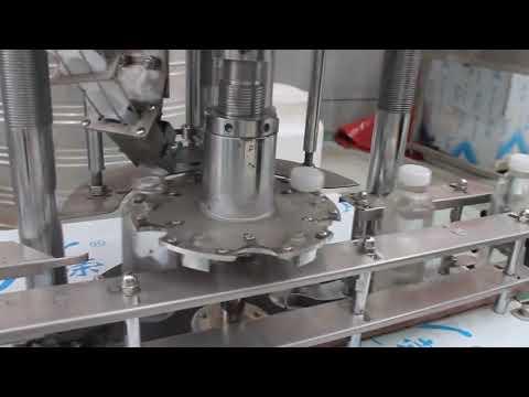 دستگاه دربندی دوار بطری پلاستیکی تک سر اتوماتیک